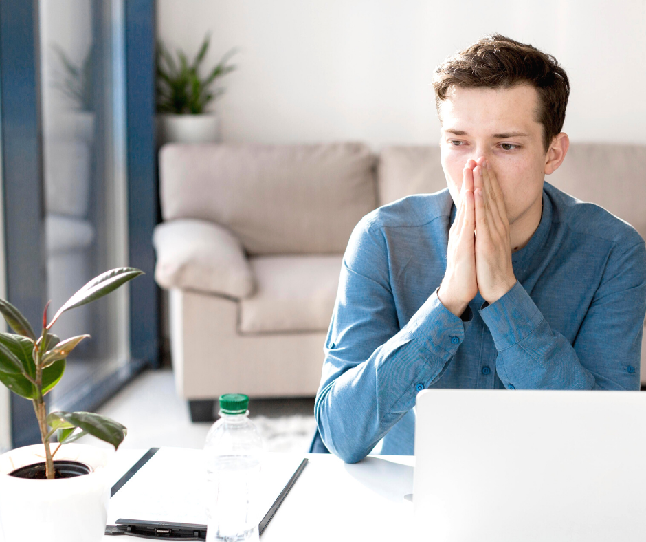 Man with reopening anxiety working remotely